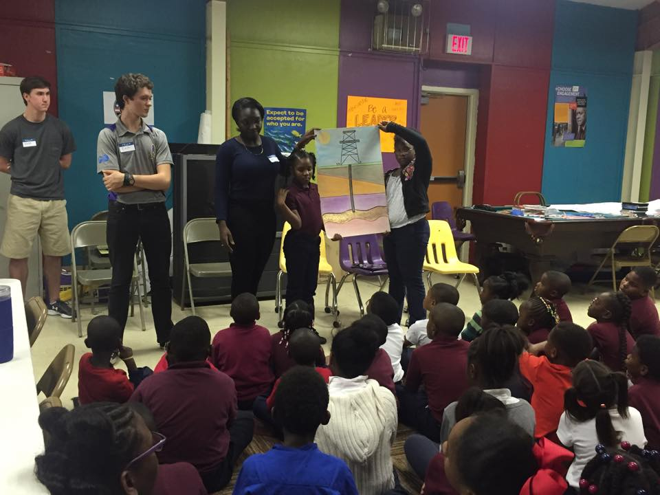 Zach Larson and Denise Owusu teach the Boys and Girls Club of Baton Rouge about petroleum engineering
